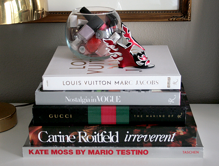 small-shop-design-books-stack-nail-polish-bowl-Prada-shoe